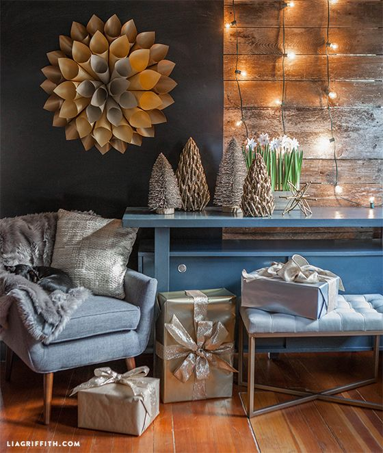 My holiday decorations gave me a perfect opportunity to add modern touches to my seasonal decor. My color palette for this year's Christmas is gold (a lot of gold), grey and warm, rustic wood tones. For me, a modern style needs that natural touch to keep it feeling cozy.@targetstyle #targetstyle #targetdecorates