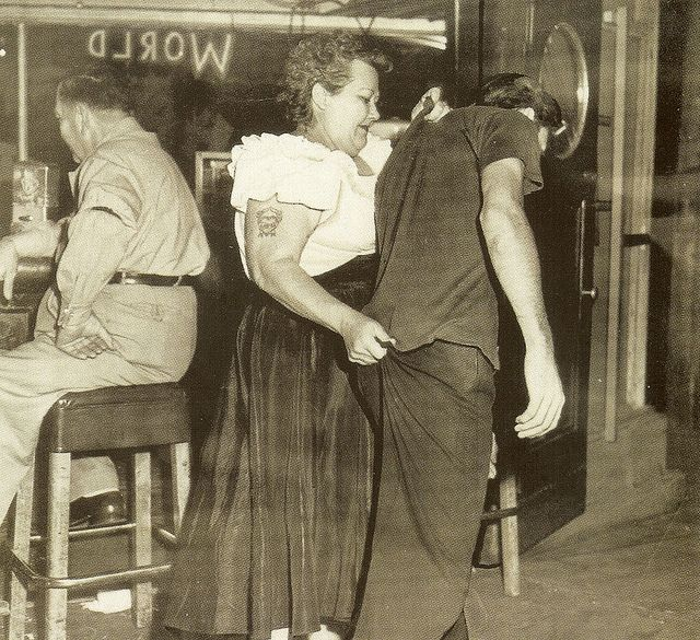 "Bouncer, ""Cairo Mary"" escorts another customer who had a tad too much fun to the door of Shanghai Reds, 5th and Beacon San Pedro 1953"