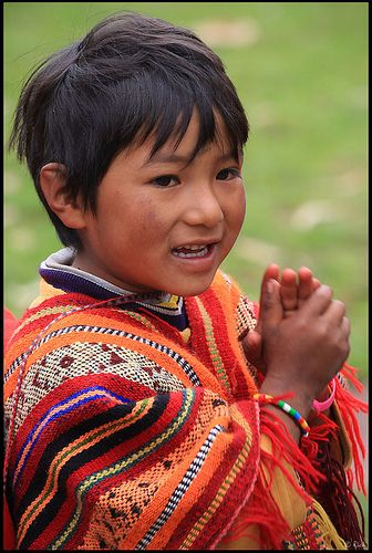 Peruvian boy in traditional clothing by rickz, via Flickr