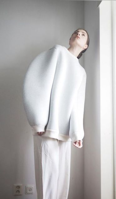 Soft geometric fashion design with sculptural sleeve detail; shape + simplicity // Maison Martin Margiela