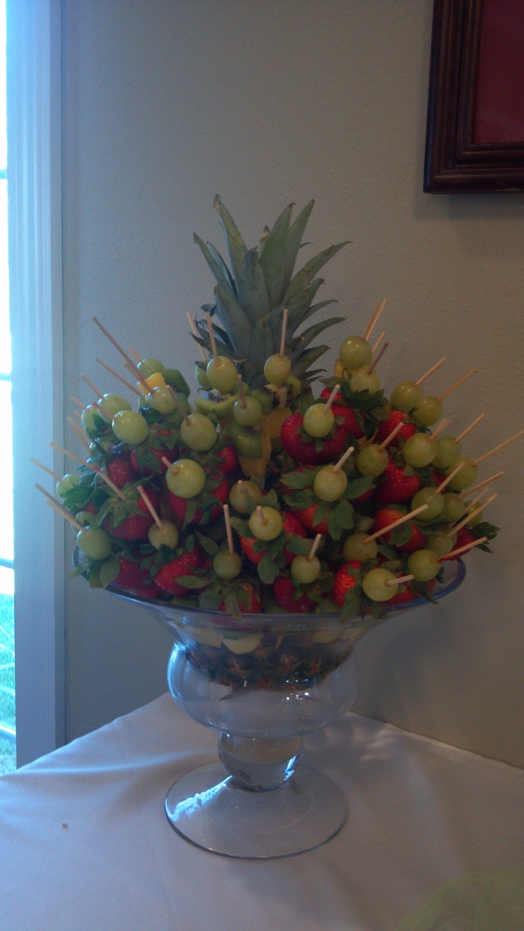 Simple Fruit Kabob Display using a footed bowl and a whole pineapple in the center.
