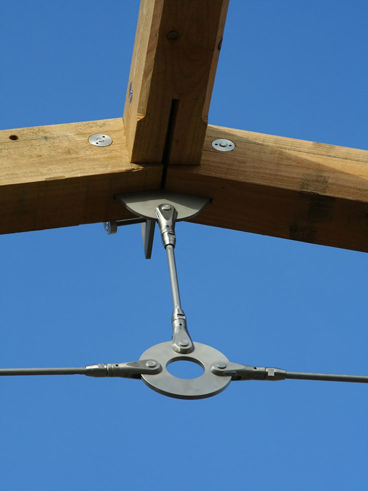 Oak and steel tie trusses for a contemporary timber frame by Carpenter Oak Cornwall.