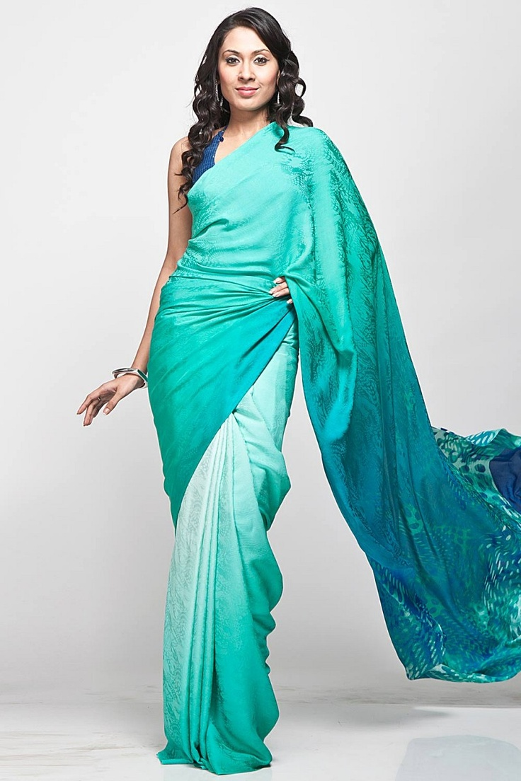 An aqua green digital printed saree in georgette jacquard fabric with embroidery, comes with an unstitched crepe-de-chine blouse piece with matching embroidery by Satya Paul $375