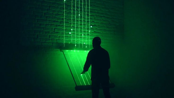 A laser harp reimagined as a controller for an interactive audiovisual experience. An installation that merges a futuristic musical instrument with a videogame. #videgames #happening #social