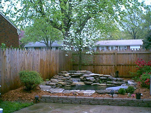 Small Pond Ideas Backyard landscaping around a pond flow back to the pond the pond small backyard A Small Retaining Wall Was Added To Raise The Depth Of The Koi Pond And Keep Pond Ideaspatio Ideasbackyard