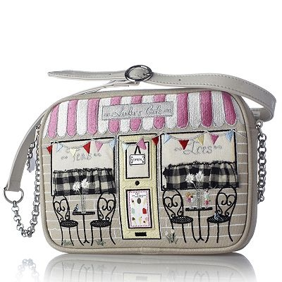 Small Emily Lulu's Cafe bag by Lulu Guinness. Features zip-accessible main compartment with a shoulder strap attached via silver-tone loops and embellished with a charming cafe illustration on the front. It's a chic and stylish bag that's full of character and ideal for brightening up a casual outfit.