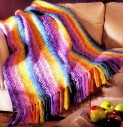 Rainbow Afghan | Add a bit of colorful cheer wherever you toss this beautiful afghan.
