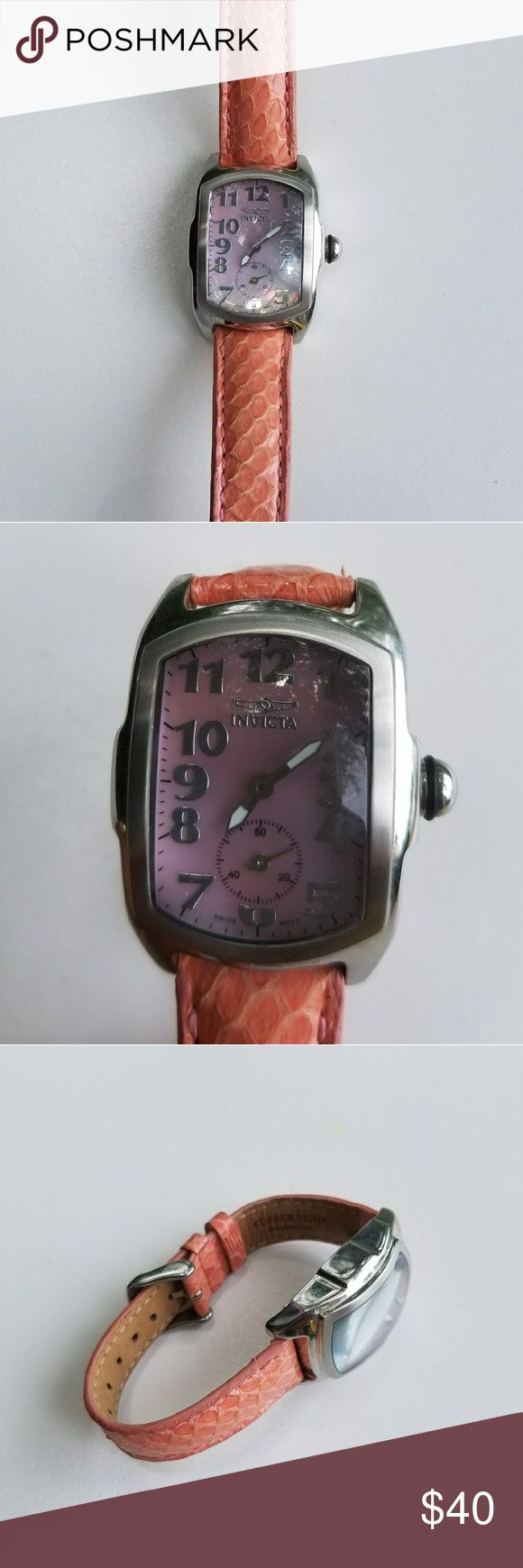 Ladies Invicta Watch Cute but durable pink ladies watch with copperhead snakeskin strap worn twice. Needs battery, reflected in asking price. Sure to be a watch to wear for many years to come Invicta Accessories Watches