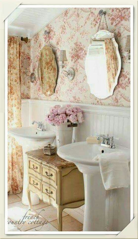 Double pedestal sinks and cabinet between
