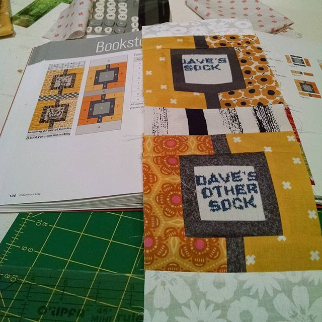 Bookstore Block. My husband wore out his eight year old socks, I had to keep part of them! I ironed on interfacing but knit is still hard to stitch. But now they will always be around :) #patchwork #patchworkquilt #patchworkcityquilt #patchworkcityqal #scrapquilt #quilt #quiltblock