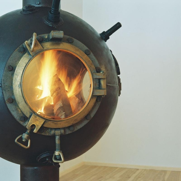 recycled Russian mine, converted into a log fireplace.