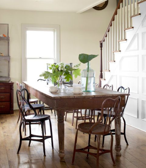 Page wrestled this poplar table from her friend and business partner, Rusty Fletcher. The metal bistro chairs date from the 1920s. Oak-leaf hydrangeas and a hosta leaf plucked from the garden outshine fussy bouquets. Bright Idea: A long table and set of chairs turn a wide hallway into a functional dining room.