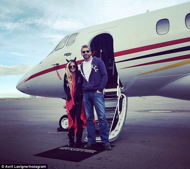 Back on?Avril Lavigne and Chad Kroeger looked very much like a couple as they touched down inCalgary in Canada on Saturday