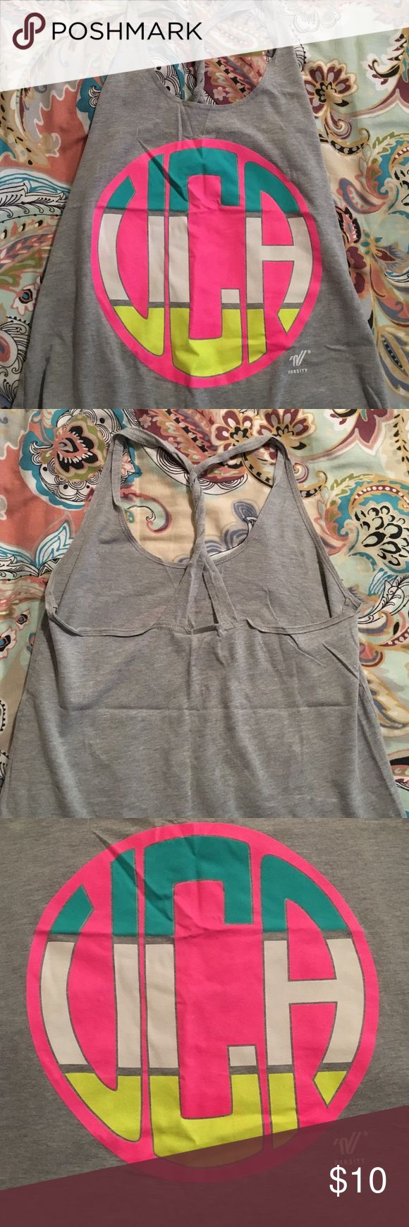 UCA Cheer tank top Only worn a few times, perfect condition! Razor back twisted! Varsity brand Varsity Tops Tank Tops