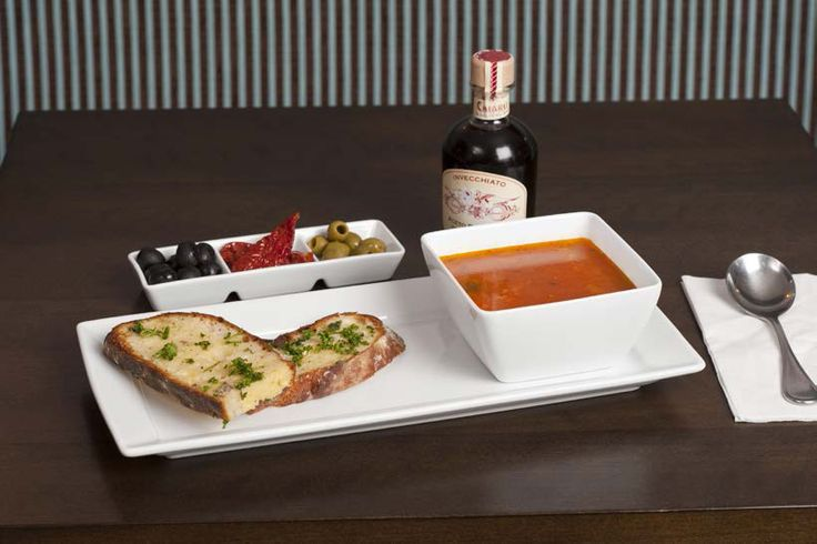 Fresh Tomato Soup and Crunchy Home Made Garlic Bread Served on Royal Porcelain Titan Square Bowl