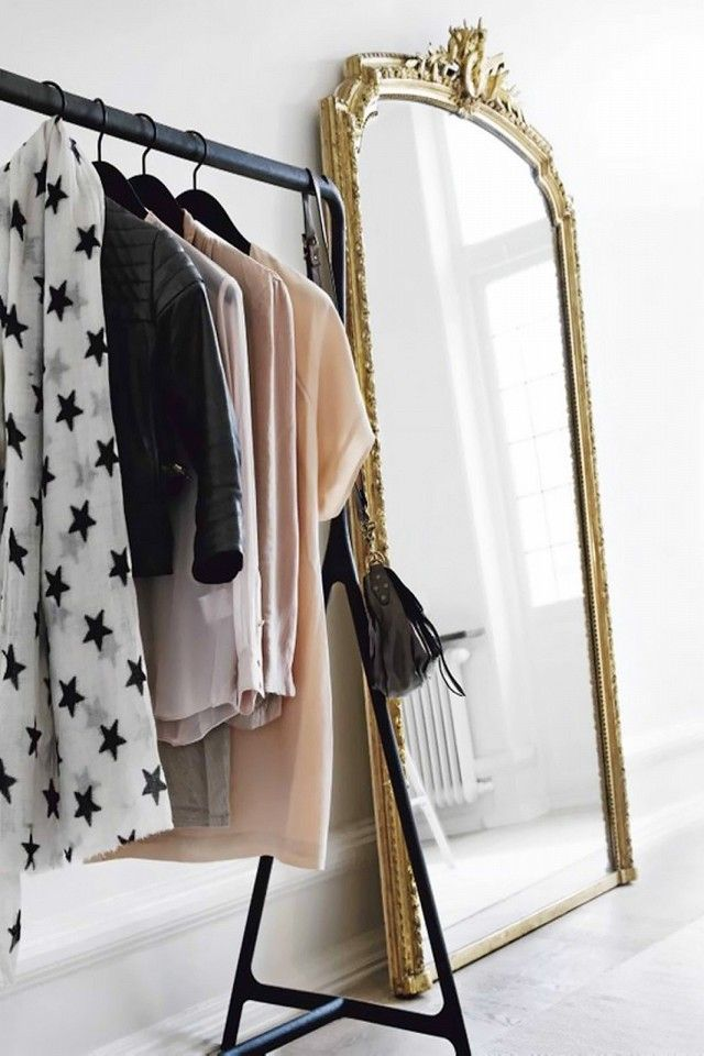 What's the perfect complement to an open closet? A large-scale French mirror, of course. It's like having your own high-end boutique in your bedroom—c'est chic.