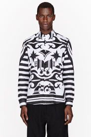 KTZ Long sleeve shirt in black. Signature graphic patterns throughout in white. Spread collar. Button closure at front. White stitching. Single-button barrel cuffs with buttoned sleeve placket. 100% cotton. Hand wash. Imported.