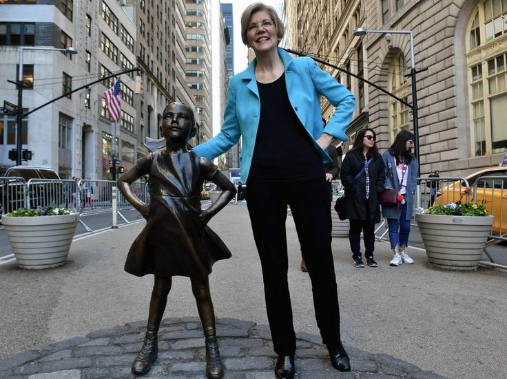 """Sen. Elizabeth Warren, a long-time critic of Wall Street and large financial institutions, posted a photo on her official Twitter on Tuesday showing her with the now-famous """"Fearless Girl"""" statue. Warren tweeted """"Fight like a girl"""" and included a ph http://aspost.com/post/Wall-Street-critic-Elizabeth-Warren-took-a-picture-with-the-famous-Fearless-Girl-statue-on-Wall-Street/21050 #finance #stockquotes #financenews #resources…"""