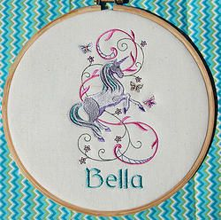 """Dancing Unicorn""  8"" machine embroidered hoop art. Personalised for your child's room. Finished with stiffened felt for your wall's protection. $22.50 #embroidered #hoop #art #embroideredhoopart"
