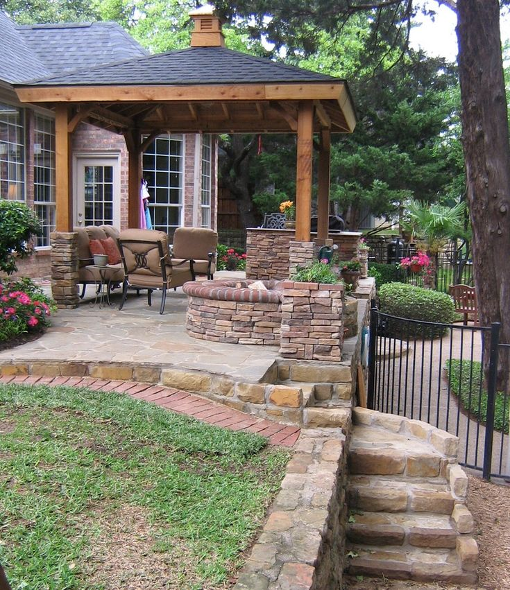 a gazebo would be nice, this whole plan is quite attractive. fence, firepit, steps... check, check, check.