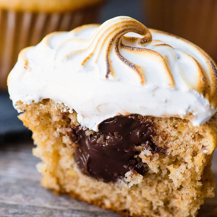 These S'mores Cupcakes feature a fluffy graham cracker cupcake and are filled with a rich soft chocolate ganache and topped with a toasted homemade marshmallow frosting. | Ashlee Marie | S'mores | Cupcake | Holiday | Dessert | #ashleemarie #dessert #cupcake #smores Ashlee Marie | Cakes, Recipes, How-to, Videos and Crafts