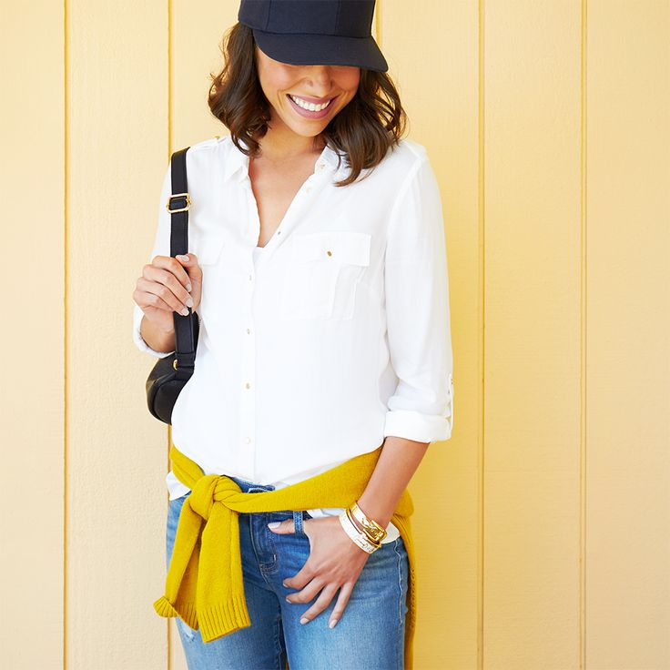 Step up your style game in 3 sporty looks for baseball season. Keep it classic with a white button down and jeans. Don't forget to sport your team's color with a fun accent, like an extra layer tied around your waist and of course your baseball cap.