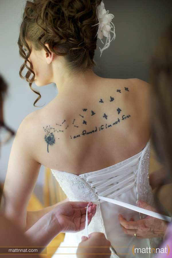 """Loving the positions of this back tattoo. I think this might be the winner for """"It takes courage to grow up and be who you really are"""" Plus I always wanted a dandelion in that position. Perfect! (: Want this next!"""
