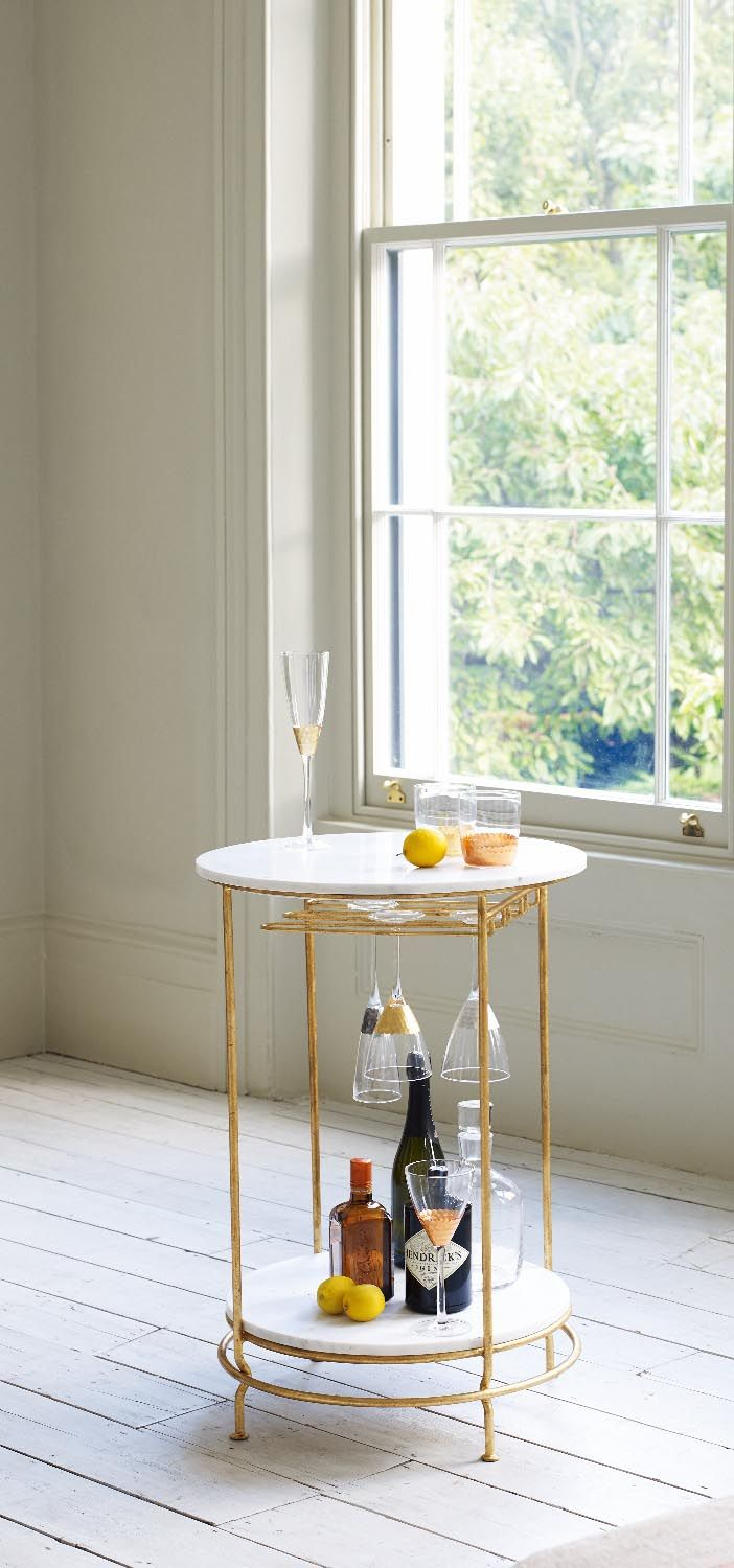 Raise the bar and channel a stylish retro vibe this party season with the sleek silhouette of our unique Luxe Bar Table.