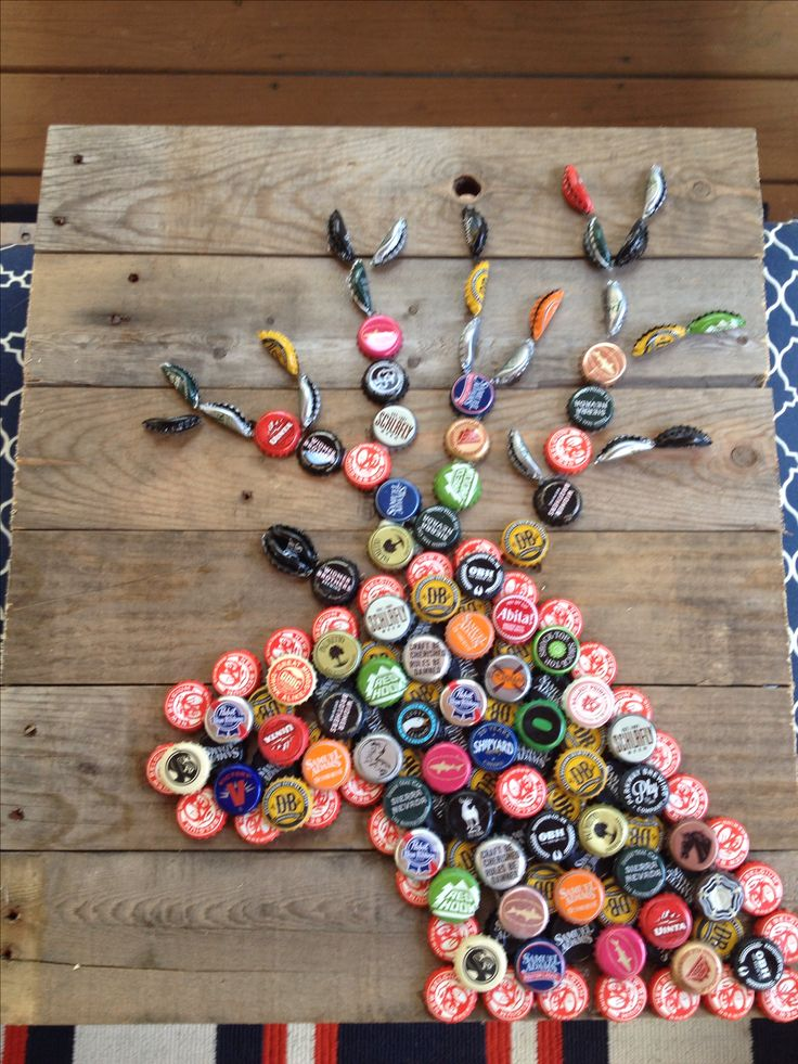 Hubby and I made this. beer cap deer. Bottle cap crafts with craft beer caps and pallet wood