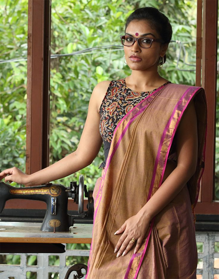 A golden brown saree with a cheeky pink and golden border. Clever meets chic. THE KAITHARI SAREE Handwoven and designed in Kerala