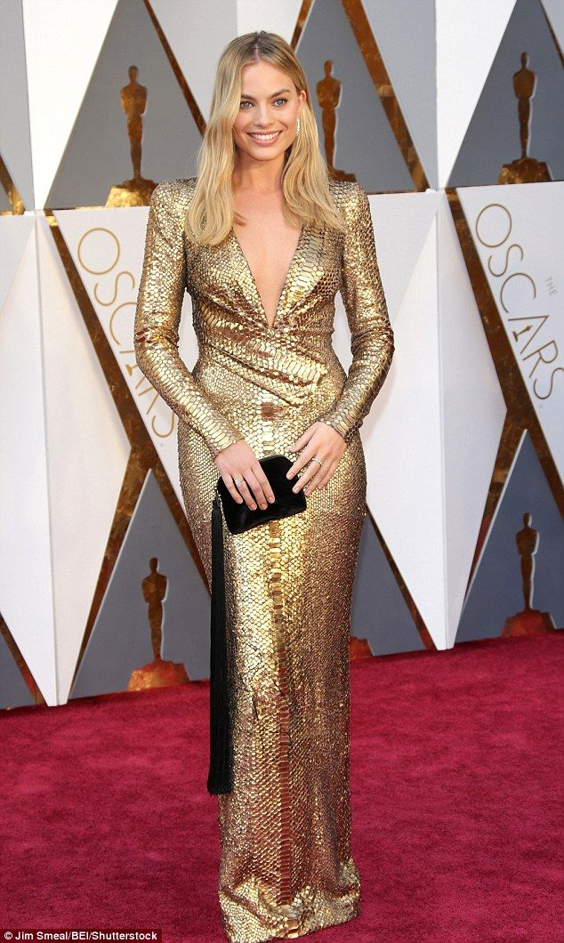 Gorgeous: The 25-year-old looked incredible in a plunging gold gown, which showed off a hi...