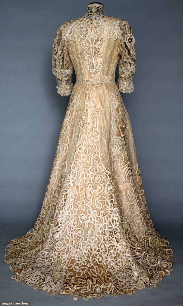 TRAINED CREAM LACE TEA GOWN, c. 1906 1 piece, handmade Battenburg lace & machine made Valenciennes lace inserts, high collar, ruffled lace elbow length sleeves.Historical Society. Back