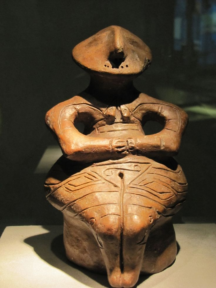 Neolithic seated smiling woman woman with happy sexual life