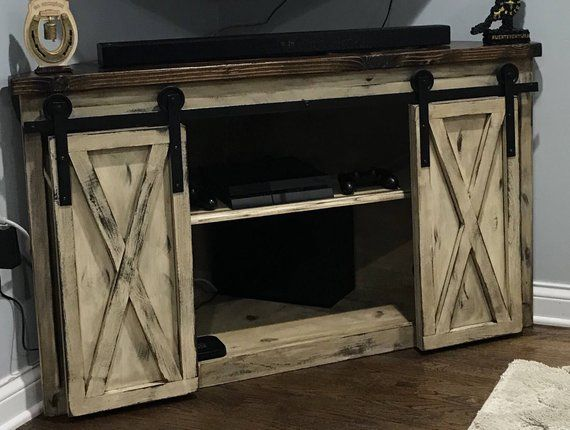 Farmhouse Corner Tv Entertainment Center With Sliding Barn Doors Cover Your Tv Components When Not In Use W Corner Tv Basement Remodeling Basement Remodel Diy