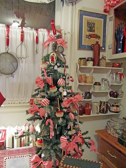 A kitchen Christmas tree, could sit up on my counter. Perhaps with numbered treat boxes on it, to be an advent/countdown tree (as shown in another pic on the same link).