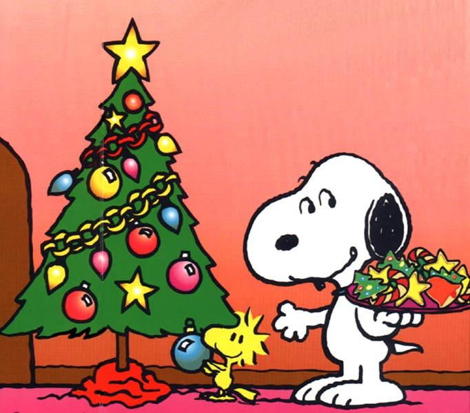 snoopy and woodstock decorating the christmas tree