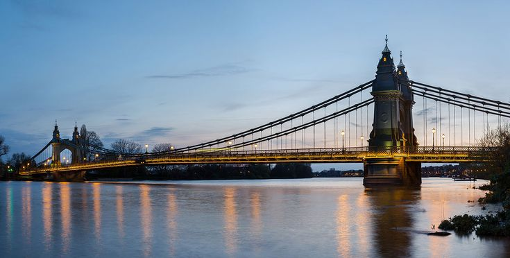 Hammersmith Bridge is a suspension bridge which crosses the River Thames in west London. The second permanent bridge on the site, the current bridge was designed by Sir Joseph Bazalgette and rests upon its predecessor's pier foundations