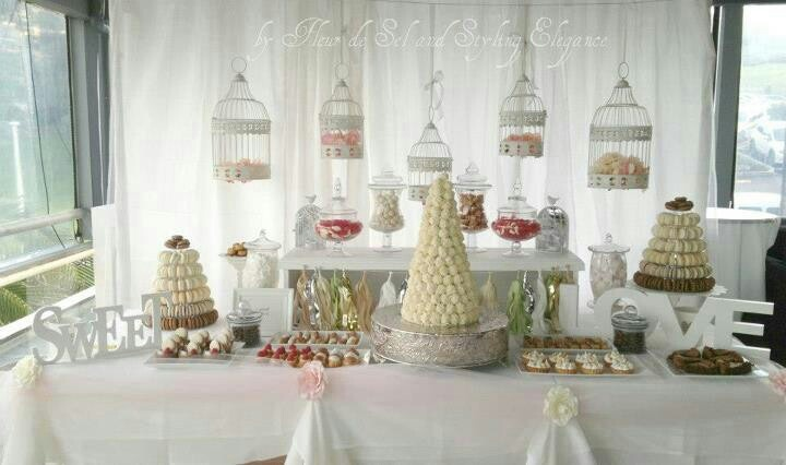 Dessert table buffet styled by styling elegance. Desserts by Fleur De Sel. Romantic, vintage, couture, pink, love birds, love is sweet,macarons, chocolate mousse, cake, tarts, financier, truffle, choux,  eclair