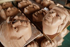 Masks of U.S. Republican presidential candidate Donald Trump are seen drying on shelves. All photographs Aly Song for Reuters
