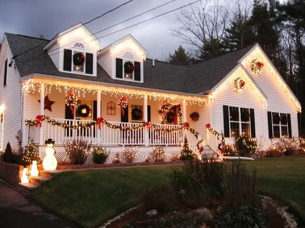 An Abundance of Wreaths—Each window on this Massachusetts home is covered by simple green wreaths for a classic Christmas look.