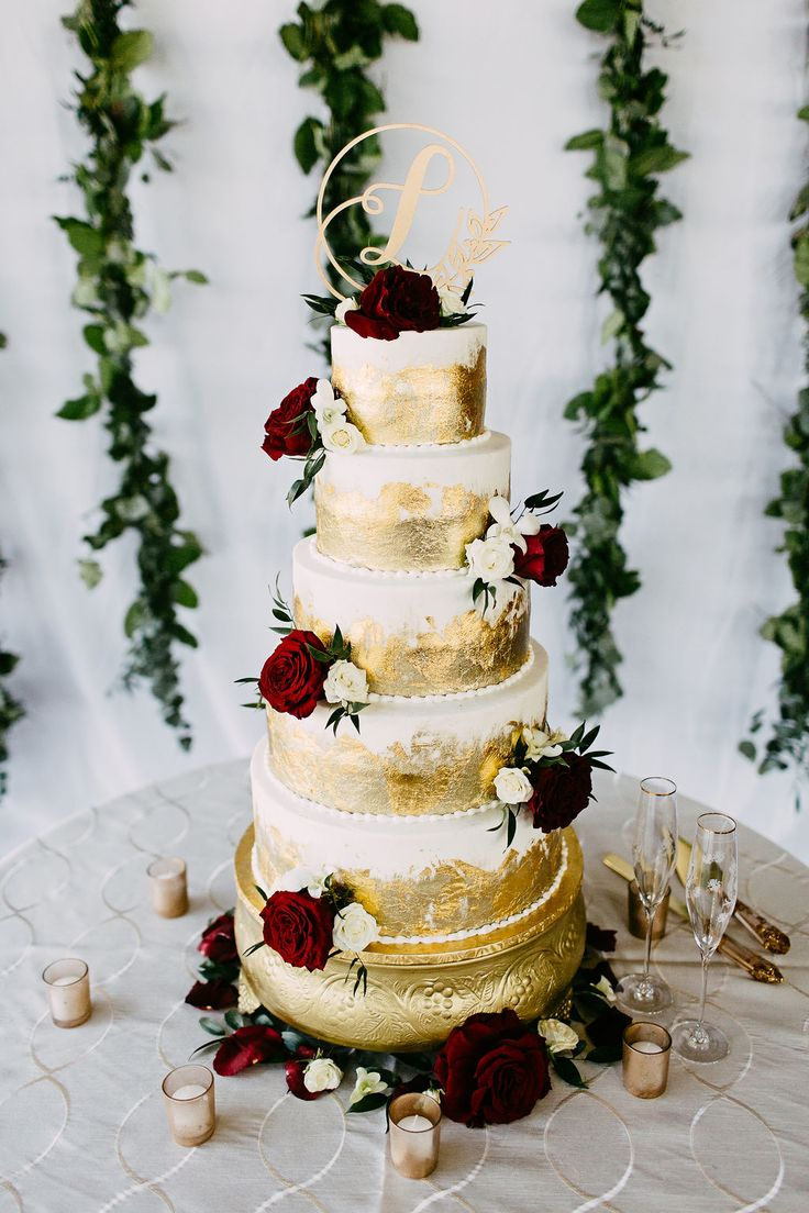 Gold foil cake with red floral accents. Cake by Kipp's