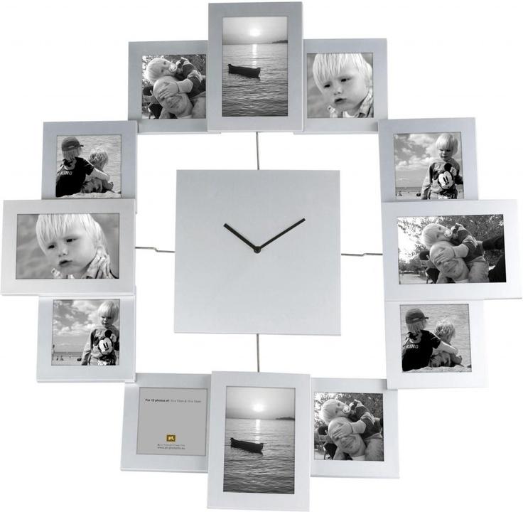 Fotoklok € 95,- Diameter 70cm.Materiaal Aluminium Kleur Zilver . 14 foto's van 10 x 15  en  8 foto's van 10 x 10 cm