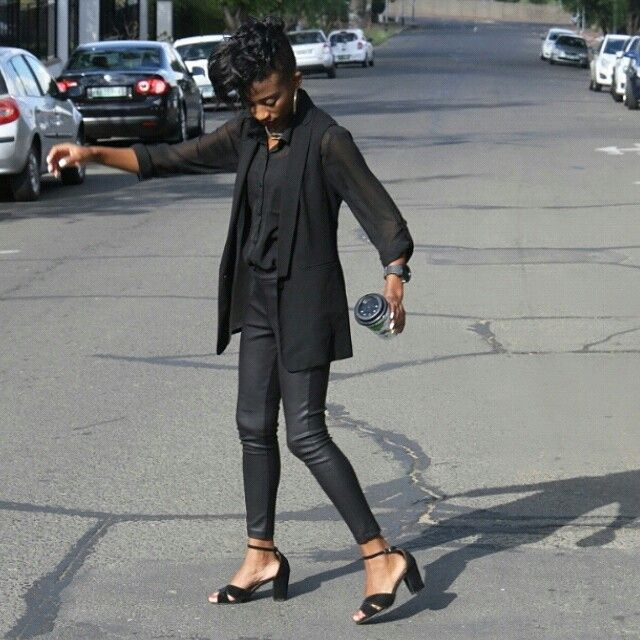 armless longline blazer, black shirt, black leather pants and black sandals
