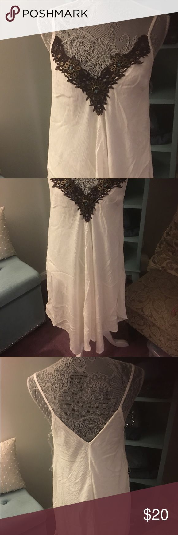 White dress/Beach cover up Nwot white v neck dress with brown crochet detail. It can also be worn as a beach cover up. Venus Dresses