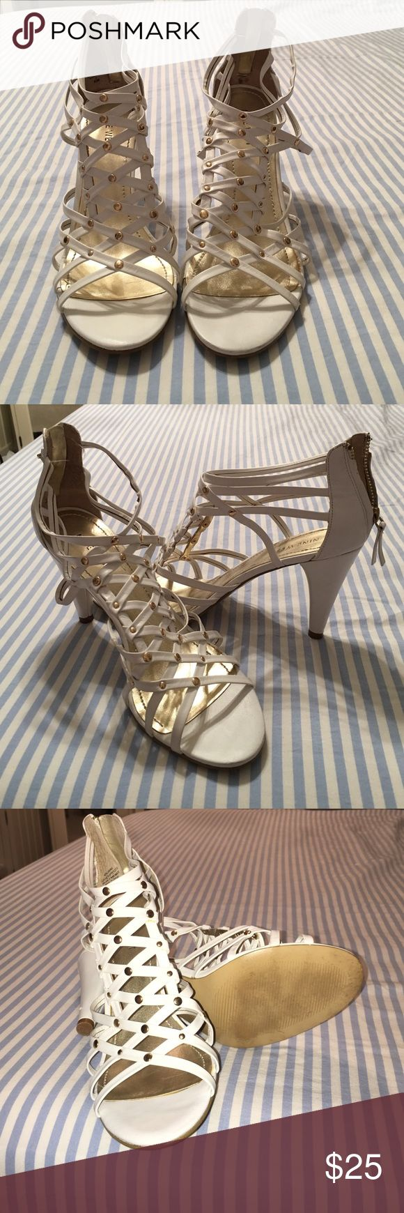 Beautiful white and gold heels Wore it once, it's has roughly about 2 and a half inch heels. It's pretty comfortable but sadly I'm flat footed so any type of heels will eventually become uncomfortable. Nine West Shoes Heels