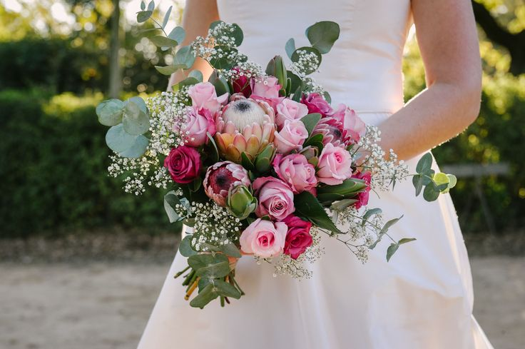 Proteas create a lovely focus point for your bouquet. Complement your protea with different shades of roses, leafy fynbos and baby's breathe like we did for this gorgeous bride.