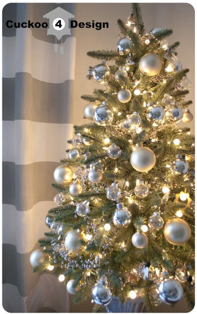 Small Tree With White Lights And Simple Silver And Gold Decorations