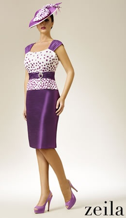 Zeila purple and cream print bodice dress with purple jacket with print collar and cuff.  Sizes 14 to 20. Price £439.