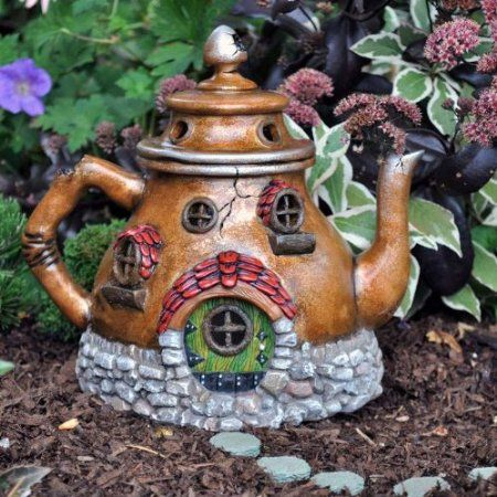 I have an old teapot i think i might try to make a fairy house out of it....Fairy Garden Teapot House