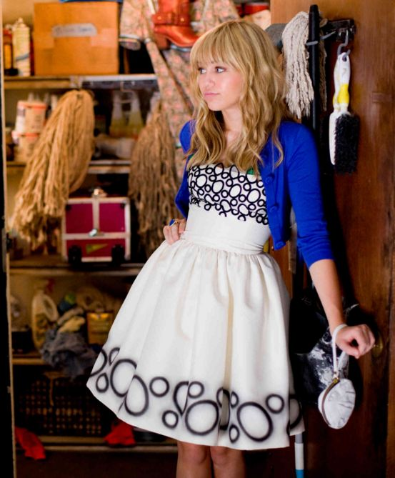 And she made you want to run to the store to buy a bold cardigan to pair with a cute dress: | 13 Hannah Montana Looks You Wanted To Pull Off In The Late 2000s